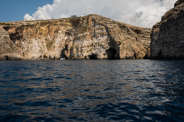 Blue grotto seen from a boat trip. Malta