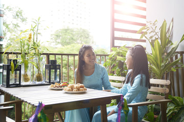 Cheerful siblings having a conversation during Hari Raya