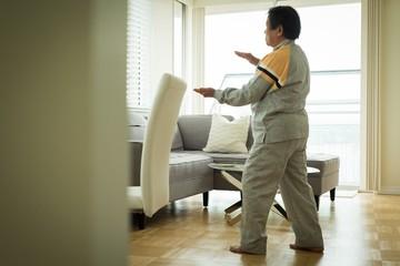 Full length of senior woman exercising at home