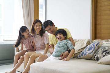 Family of four bonding at home