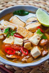 vegetarian thai broth pho soup with fried tofu, shiitake mushrooms and chili.