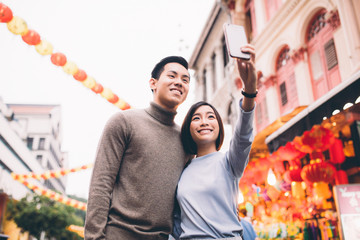 Couple doing a selfie in Chinatown, Singapore