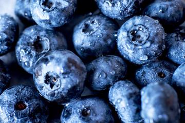Contrast macro photo food, summer fresh juicy ripe berries, blueberries on gray background