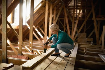 Senior woman doing carpentry work