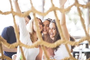 Three beautiful young woman having fun at party on boat