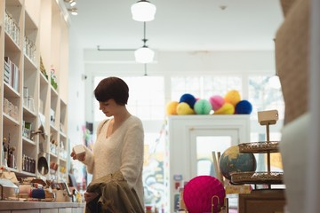 Young woman shopping in the store