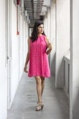 Pretty Indian lady in pink dress