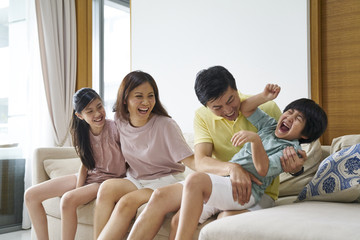 Cheerful family of four bonding at home