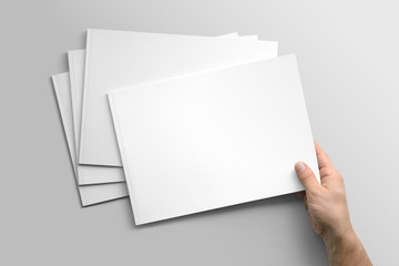 Blank A4 photorealistic landscape brochure mockup on light grey background.