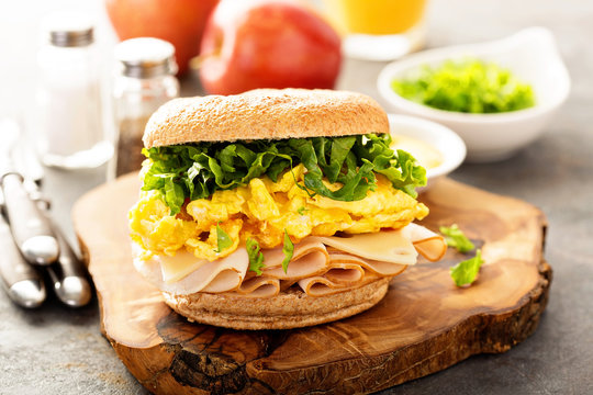 Breakfast bagel with scrambled eggs and turkey