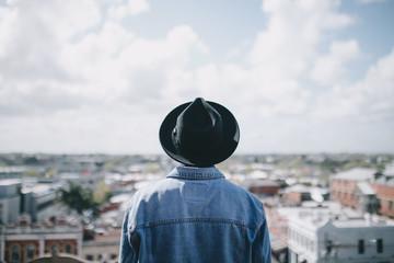 Single young man enjoying city view