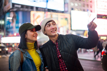 Happy times with young asian couple in Times Square
