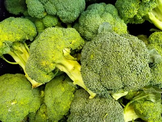 close up of raw broccoli florets at the market