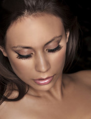 Beautiful womans face eye makeup and lashes