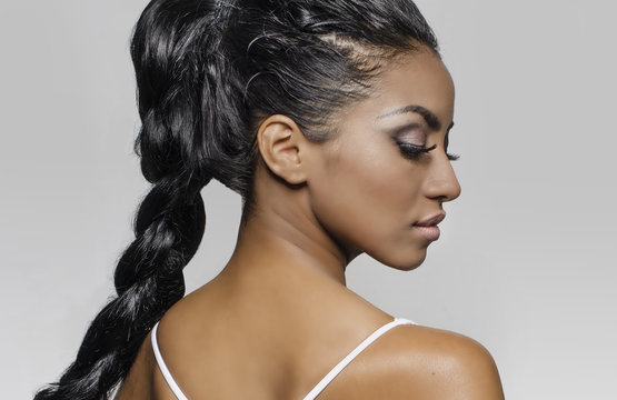 Braided hair profile face African American model.