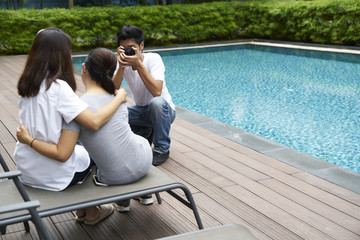 Stylish photographer shooting two young female models