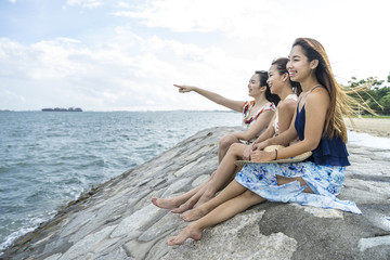 A group of young ladies chilling by the beach