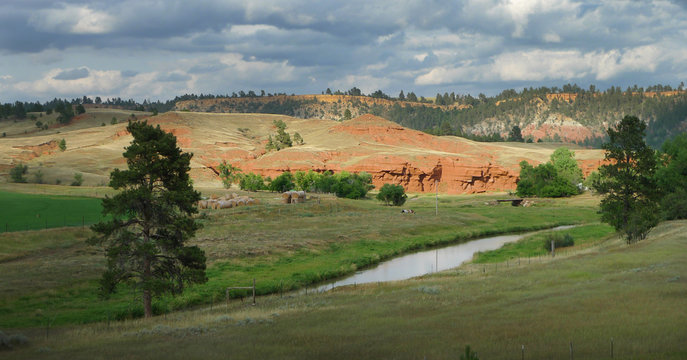 Eastern Wyoming landscape with red rock, prairie and beautiful skies