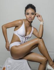 Beautiful exotic young woman wearing swimwear