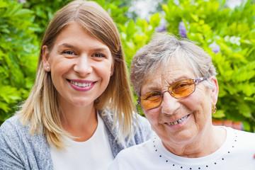Happy senior woman with caretaker