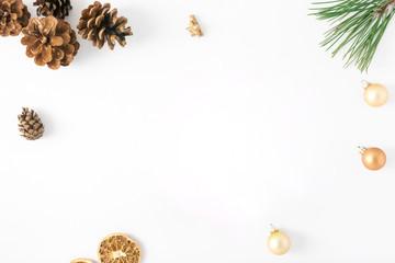 Frame of fir branch, pine cones, dry orange, Christmas balls