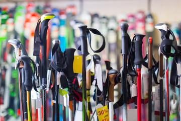 ski-sticks on showcase of store