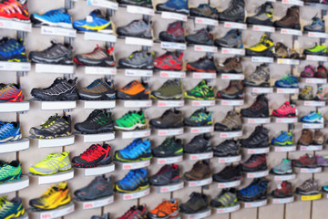 Image of sport shoes on showcase of sports shop
