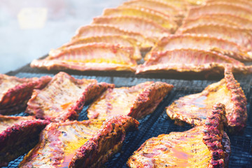 pork ribs preparing on grill brazier