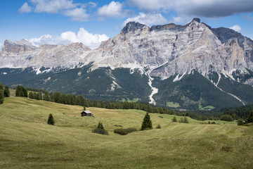 Mountain panorama with Old wooden hut