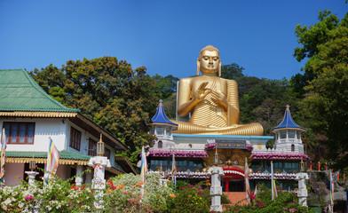Giant Gold Buddha Sculpture at Dambulla Cave Temple in Sri Lanka