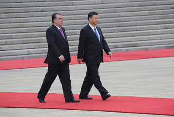 China's President Xi Jinping and Tajikistan's President Emomali Rahmon attend a welcoming ceremony in Beijing