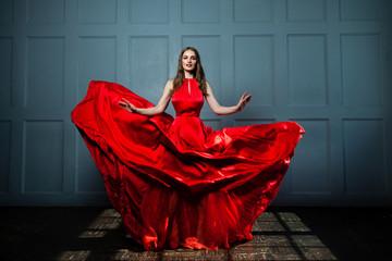 Beautiful Fashion Model Woman in Red Silky Dress. Beautiful Woman, Full Portrait
