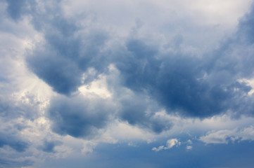 Blue fluffy storm clouds in the blue sky