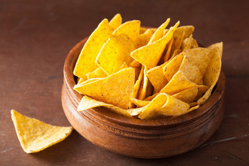 mexican nacho chips on brown background