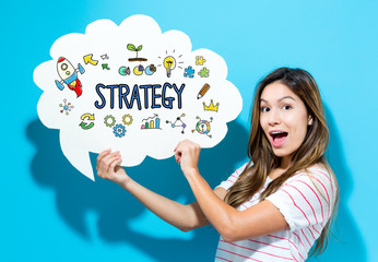 Strategy text with young woman holding a speech bubble on a blue background