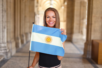 Young woman smile with flag of Argentina