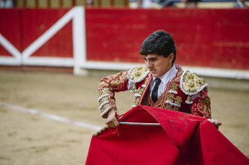 Bullfighter in a bullring.