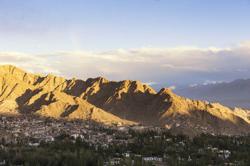sunset Aerial view of Leh city with Mountain and blue sky in the evening from Leh Palace, India