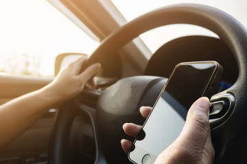 Lady using mobile phone while driving car dangerously