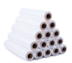 A pyramid stacked with rolls of stretch film on a white background.