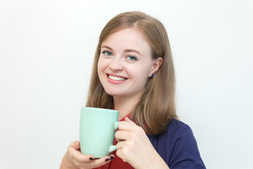 Young caucasian girl with a cup of some drink