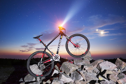 Mountain carbon bike and stars