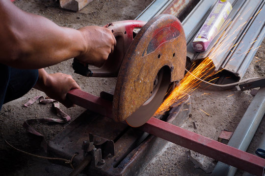Worker use grinder to cut the tube.