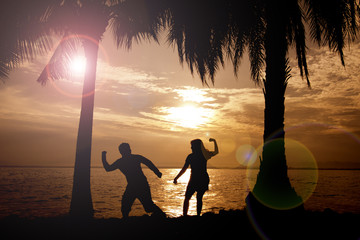 romantic couples, young handshake at sunrise or sunset.