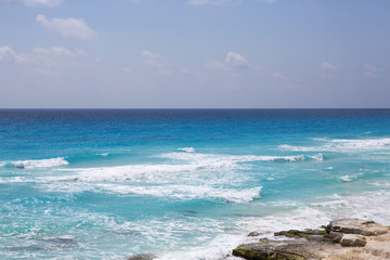 View to the sea from high above big cliffs. The Caribbean ocean and turquoise waters with horizon line.