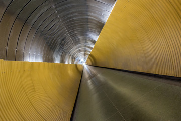 Underground pedestrian tunnel.  Twisted perspective with modern design, horizontal composition.