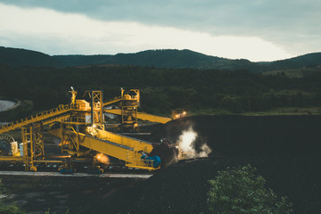 Night photography of huge coal mine digger machine or excavator.