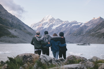 Group of friends enjoying the view at Milford Sound, New Zealand