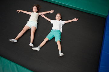 Little children are jumping on the trampoline