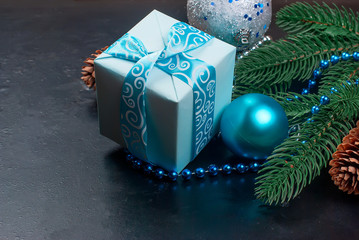 Christmas branches, balls, gift box, cones,  Christmas background.